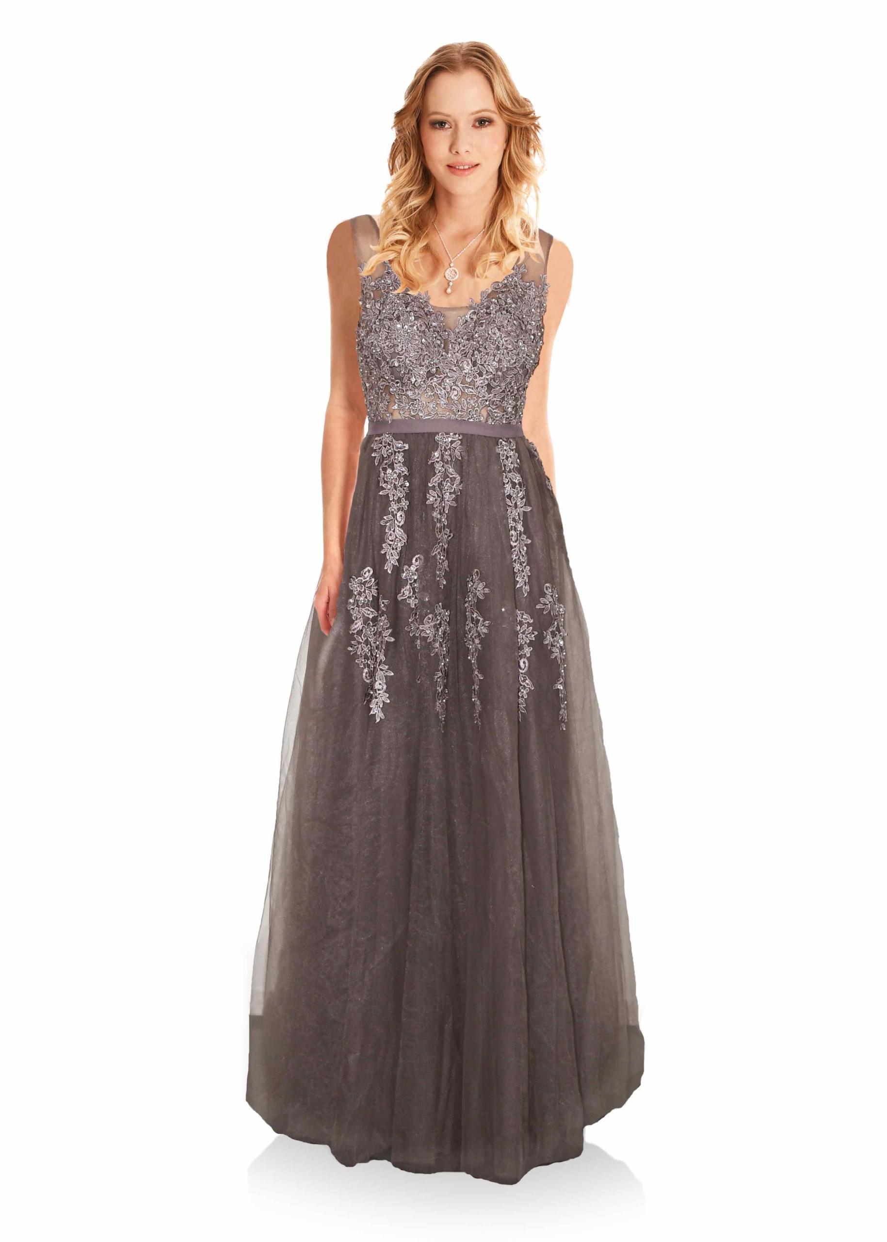 Atemberaubendes Abendkleid aus Tüll mit Spitze verziert und V-Ausschnitt am  Rücken.